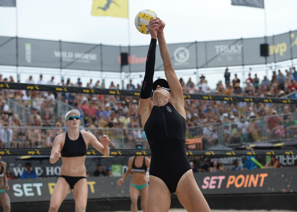 . Brittany Hochevar keeps the ball in play as her partner Emily Day, left, looks on during the AVP Hermosa Beach Women\'s Championship match, at Hermosa Beach. Brittany Hochevar and her partner Emily Day won 21-17,21-13 over Angela Bensend and her partner Geena Urango.    Hermosa Beach, Sunday, July 23, 2017.            ( Photo by Stephen Carr /  Daily Breeze / SCNG )