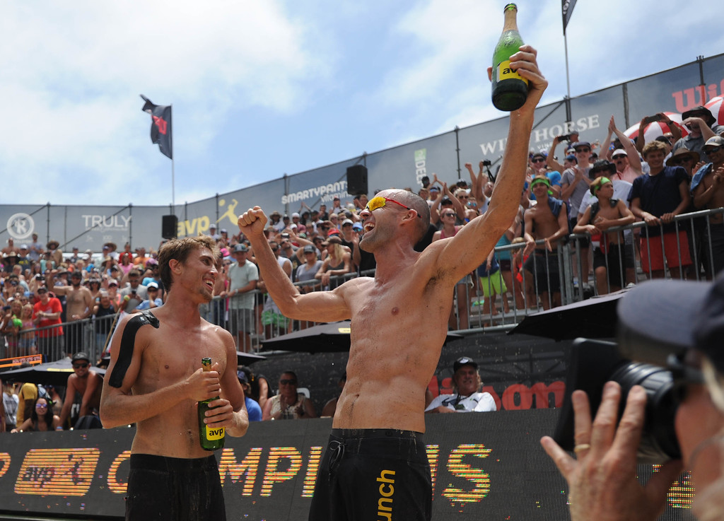 . Taylor Crabb,left, celebrates with his partner Jake Gibb after the two won the AVP Hermosa Beach Men\'s Championship match, at Hermosa Beach.  They won 21-16,17-21,15-11, over Trevor\'s brother Trevor Crabb and his partner Sean Rosenthal.    Hermosa Beach, Sunday, July 23, 2017.            ( Photo by Stephen Carr /  Daily Breeze / SCNG )