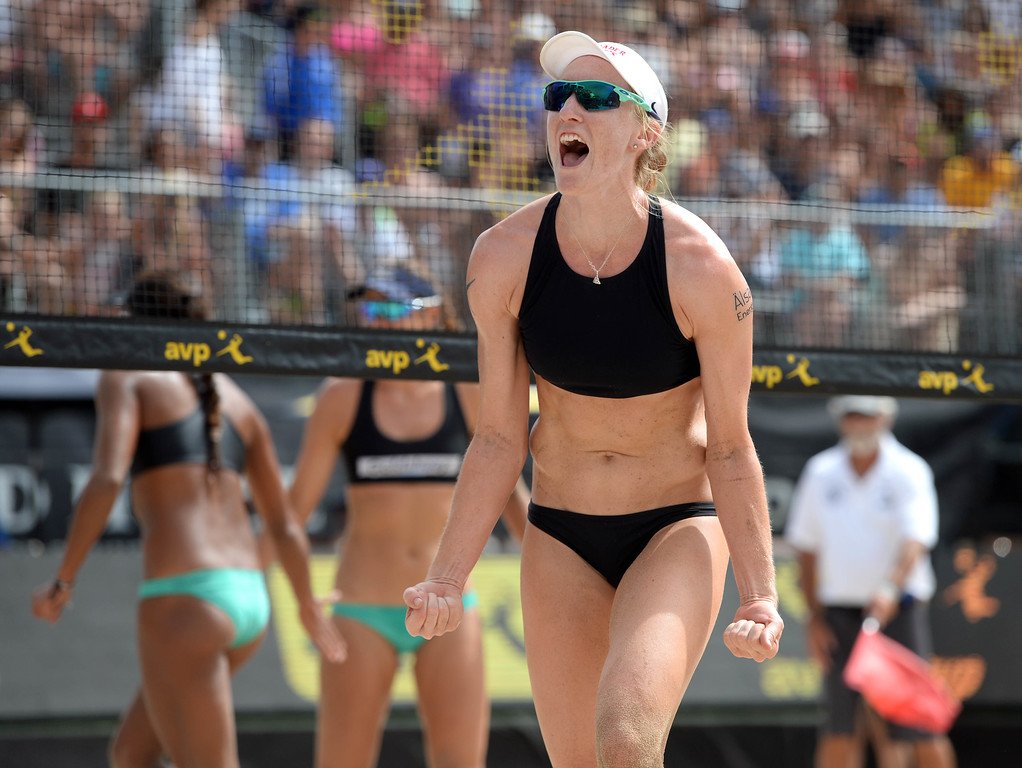. Emily Day celebrates a block ,left, against Angela Bensend and Geena Urango,  during the AVP Hermosa Beach Women\'s Championship match, at Hermosa Beach. Emily Day and her partner Brittany Hochevar won 21-17, 21-13.     Hermosa Beach, Sunday, July 23, 2017.            ( Photo by Stephen Carr /  Daily Breeze / SCNG )