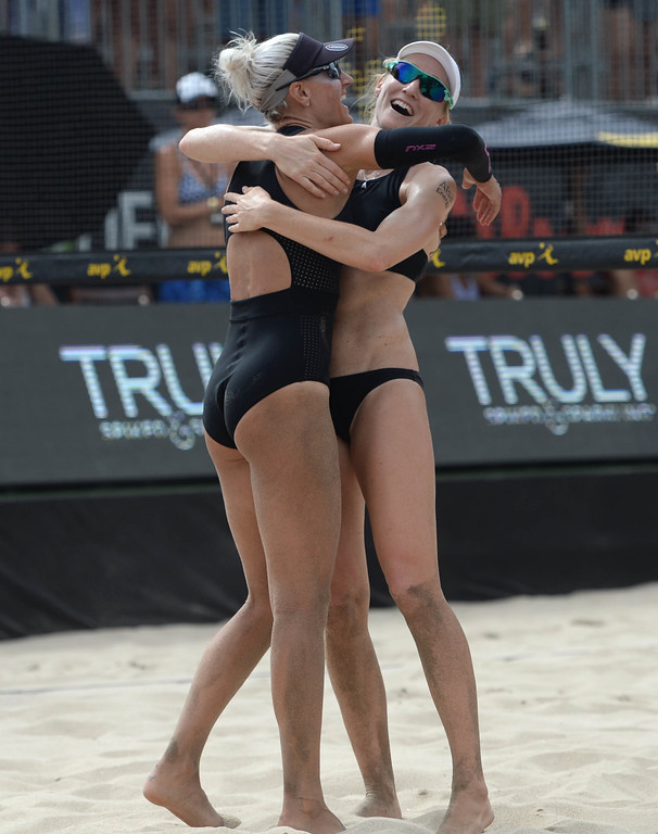 . Brittany Hochevar,left, and her partner Emily Day celebrate after winning the AVP Hermosa Beach Women\'s Championship match, at Hermosa Beach, winning 21-17, 21-13 over Angela Bensend and her partner Geena Urango.    Hermosa Beach, Sunday, July 23, 2017.            ( Photo by Stephen Carr /  Daily Breeze / SCNG )