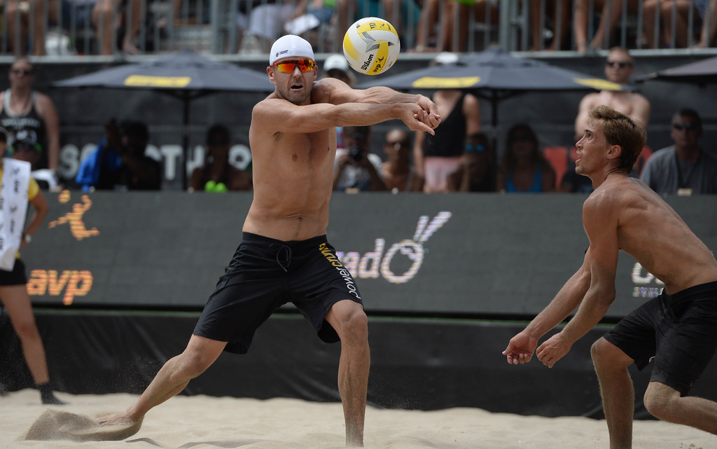 . Jake Gibb,left, and partner Taylor Crabb,during the AVP Hermosa Beach Men\'s Championship match, at Hermosa Beach.  The two won 21-16,17-21,15-11, over Trevor\'s brother Trevor Crabb and his partner Sean Rosenthal.    Hermosa Beach, Sunday, July 23, 2017.            ( Photo by Stephen Carr /  Daily Breeze / SCNG )