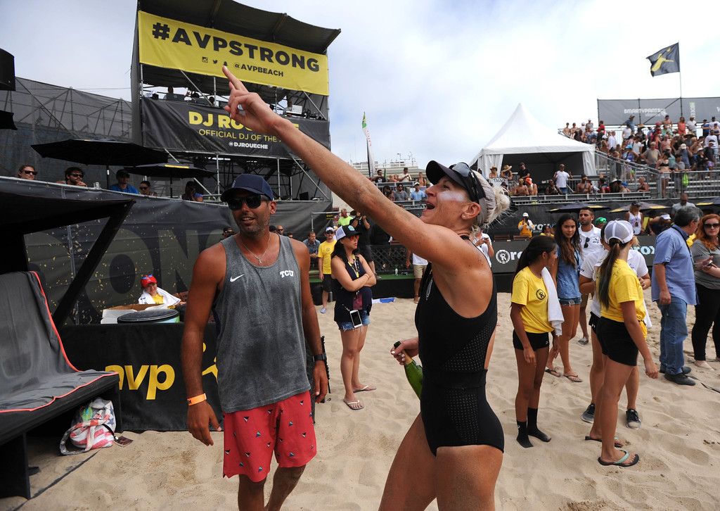 . Brittany Hochevar celebrates after winning with her partner Emily Day, the AVP Hermosa Beach Women\'s Championship match, at Hermosa Beach, winning 21-17, 21-13 over Angela Bensend and her partner Geena Urango.    Hermosa Beach, Sunday, July 23, 2017.            ( Photo by Stephen Carr /  Daily Breeze / SCNG )