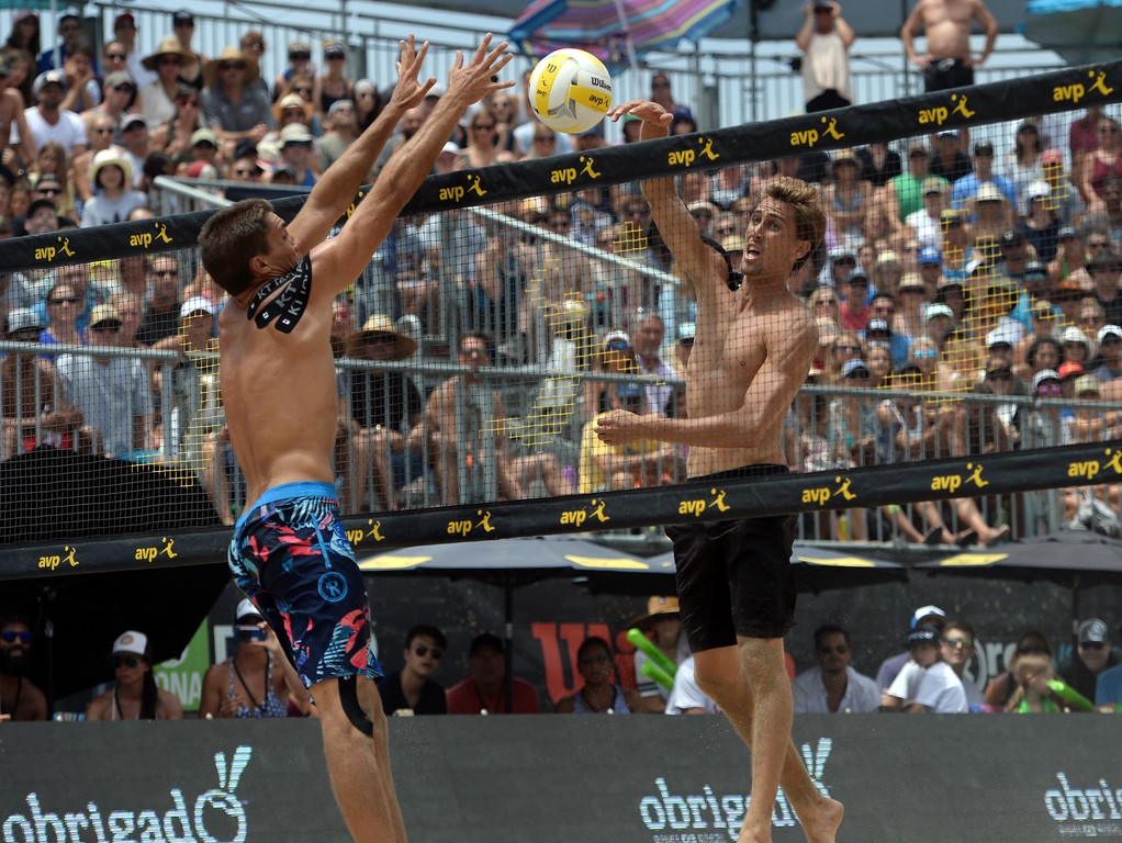. Trevor Crabb,left, misses the block as his brother Taylor Crabb, right,as he spikes the ball for a point during the AVP Hermosa Beach Men\'s Championship match, at Hermosa Beach. Taylor Crabb and his partner Jake Gibb won 21-16,17-21,15-11, over  Trevor Crabb and his partner Sean Rosenthal.    Hermosa Beach, Sunday, July 23, 2017.            ( Photo by Stephen Carr /  Daily Breeze / SCNG )