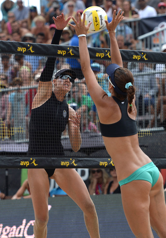 . Brittany Hochevar,left, spikes the ball past Angela Bensend during the AVP Hermosa Beach Women\'s Championship match, at Hermosa Beach. Brittany Hochevar and her partner Emily Day won 21-17,21-13 over Angela Bensend and her partner Geena Urango.    Hermosa Beach, Sunday, July 23, 2017.            ( Photo by Stephen Carr /  Daily Breeze / SCNG )