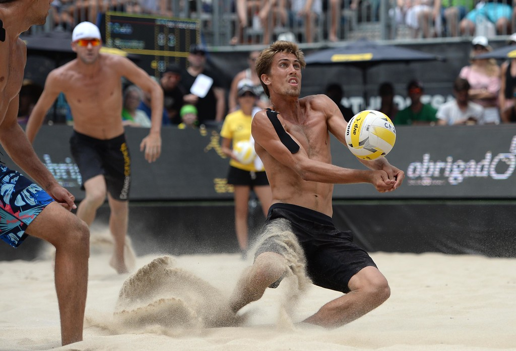 . Taylor Crabb, right, dives for the ball against his against His brother Trevor Crabb,left, during the AVP Hermosa Beach Men\'s Championship match, at Hermosa Beach. Taylor Crabb and his partner Jake Gibb won 21-16,17-21,15-11, over  Trevor Crabb and his partner Sean Rosenthal.    Hermosa Beach, Sunday, July 23, 2017.            ( Photo by Stephen Carr /  Daily Breeze / SCNG )