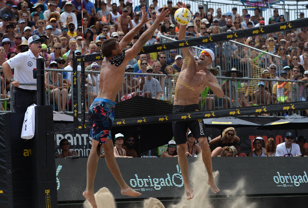 . Trevor Crabb,left, misses the block against Jake Gibb, right, as he spikes the ball for a point during the AVP Hermosa Beach Men\'s Championship match, at Hermosa Beach. Jake Gibb and his partner Taylor Crabb won 21-16,17-21,15-11, over Trevor Crabb and his partner Sean Rosenthal.    Hermosa Beach, Sunday, July 23, 2017.            ( Photo by Stephen Carr /  Daily Breeze / SCNG )