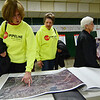 Christine Budd and Ruth Stevens, both of Pepperell, attend an open house by Tennessee Gas Pipeline Company, L.L.C. at Memorial Intermediate School in Fitchburg on Thursday evening. SENTINEL & ENTERPRISE / Ashley Green