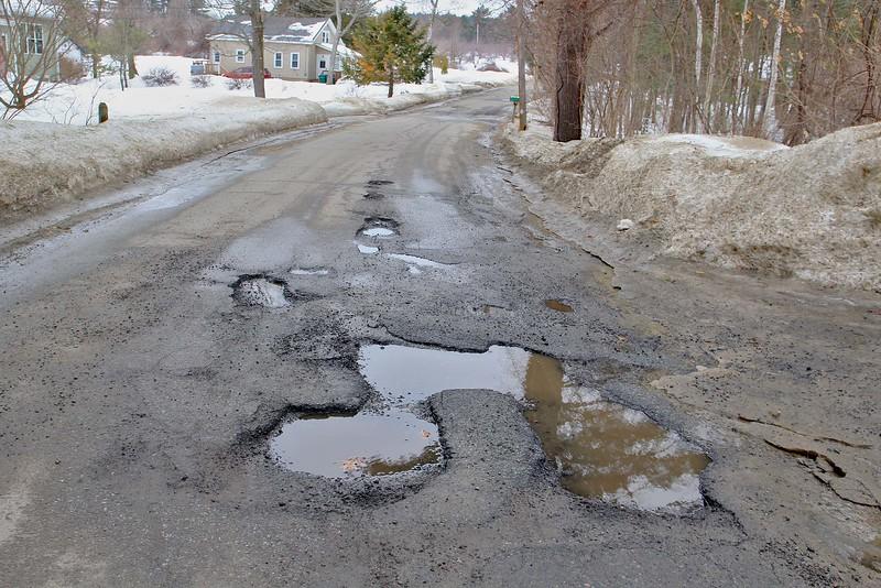 Potholes on Richardson Road in Fitchburg.SENTINEL & ENTERPRISE/JOHN LOVE