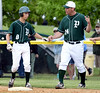 Bob Raines--Montgomery Media / Pennridge assistant coach Dave Hollenbach congratulates Andrew Mayhew on his base hit during the May 18, 2015 game at West Chester Rustin.
