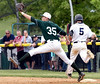 Bob Raines--Montgomery Media / Pennridge first baseman Tommy Nuneviller stretches for the throw, but West Chester Rustin's Matt Coates reaches the bag first May 18, 2015.
