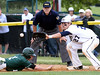 Bob Raines--Montgomery Media / Pennridge's Danny Shane is out trying to get back to first after getting caught off the bag.  West Chester Rustin first baseman Charlie Concannon makes the play May 18, 2015.