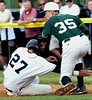 Bob Raines--Montgomery Media / Pennridge first baseman Tommy Nuneviller loses the ball when the helmet of West Chester Rustin's Charlie Concannon hits his forearm May 18, 2015.