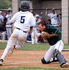 Bob Raines--Montgomery Media / Pennridge catcher Riley Hager bobbles the throw to the plate allowing West Chester Rustin's Matt Coates to score, tying the game May 18, 2015.