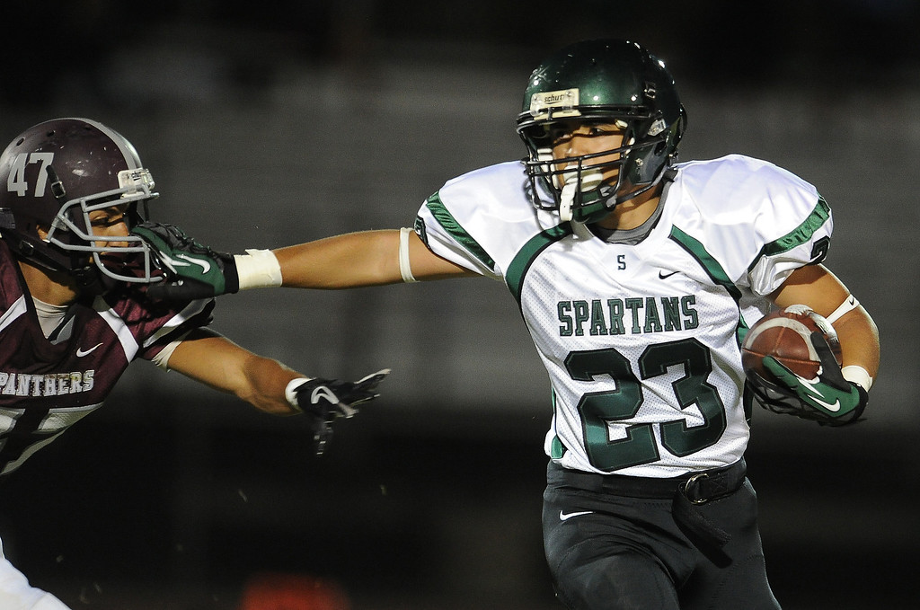 . South Torrance\'s Brandon Chavez (23) runs past Rosemead\'s Jasper Chavez (C) (34) for a first down in the first half of a prep football game at Rosemead High School in Rosemead, Calif. on Thursday, Sept. 12, 2013.   (Photo by Keith Birmingham/Pasadena Star-News)