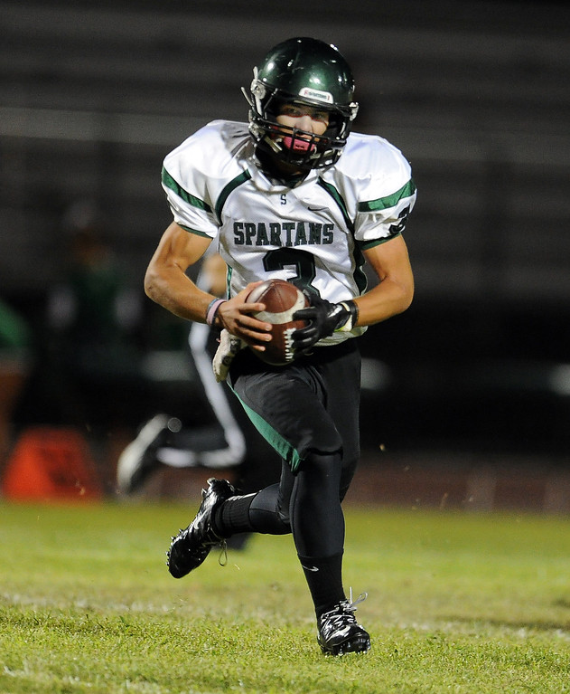 . South Torrance\'s Anthony Peters (3) runs for yardage against Rosemead in the first half of a prep football game at Rosemead High School in Rosemead, Calif. on Thursday, Sept. 12, 2013.   (Photo by Keith Birmingham/Pasadena Star-News)