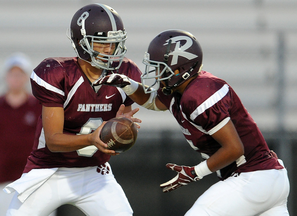 . Rosemead quarterback Isaia Ah-hing (8) hands-off to Angel Lopez in the first half of a prep football game at Rosemead High School in Rosemead, Calif. on Thursday, Sept. 12, 2013.   (Photo by Keith Birmingham/Pasadena Star-News)