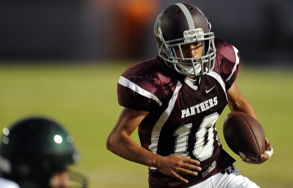 . Rosemead\'s Patrick Lopez (10) runs for a touchdown against South Torrance in the first half of a prep football game at Rosemead High School in Rosemead, Calif. on Thursday, Sept. 12, 2013.   (Photo by Keith Birmingham/Pasadena Star-News)