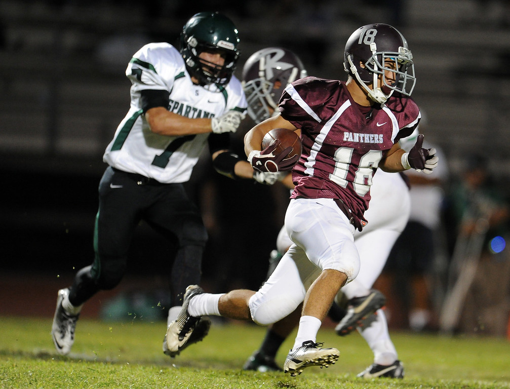 . Rosemead\'s Stephen Cansino (16) runs for a first down against South Torrance in the first half of a prep football game at Rosemead High School in Rosemead, Calif. on Thursday, Sept. 12, 2013.   (Photo by Keith Birmingham/Pasadena Star-News)
