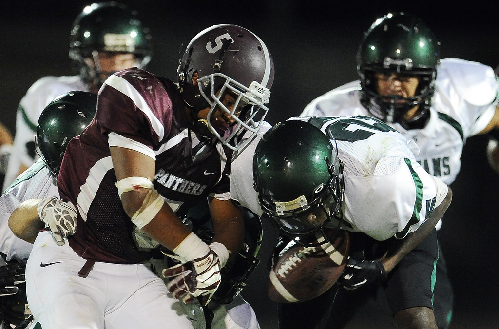 . Rosemead\'s Angel Lopez (5) funnels as South Torrance (25) recovers and score a touchdown in the first half of a prep football game at Rosemead High School in Rosemead, Calif. on Thursday, Sept. 12, 2013.   (Photo by Keith Birmingham/Pasadena Star-News)