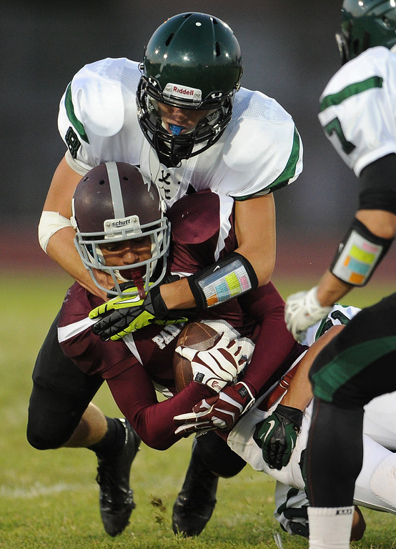 . Rosemead\'s Luis Luna (3) is  tackles by South Torrance\'s Ben Sampson (8) in the first half of a prep football game at Rosemead High School in Rosemead, Calif. on Thursday, Sept. 12, 2013.   (Photo by Keith Birmingham/Pasadena Star-News)