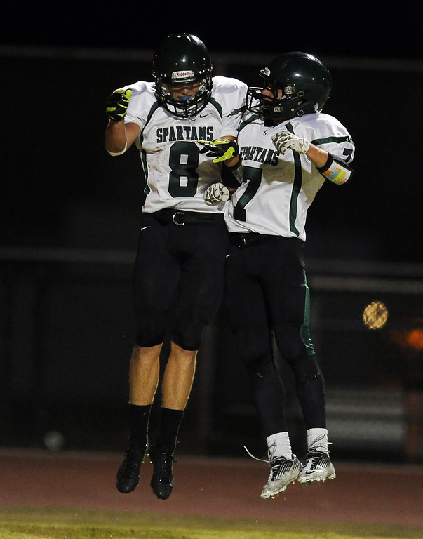 . South Torrance\'s Ben Sampson (8) reacts with teammate Vinni Bjazevich (7) after scoring a touchdown against Rosemead in the first half of a prep football game at Rosemead High School in Rosemead, Calif. on Thursday, Sept. 12, 2013.   (Photo by Keith Birmingham/Pasadena Star-News)