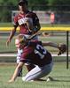 Bob Raines--Montgomery Media / Abington's Jaime Gossdin skids to a halt after fielding a Souderton fly ball. May 20, 2015