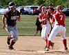 Bob Raines--Montgomery Media   / Souderton's Savannah Bostwick shovels the ball to fist baseman Kate Kehler to force Abington's Maddie Malfara  May 20, 2015