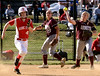 Bob Raines--Montgomery Media / Abington first baseman Jess Paley pounces on Alex Gaydos' bunt and throws her out at first during the May 20, 2015 game at Souderton.