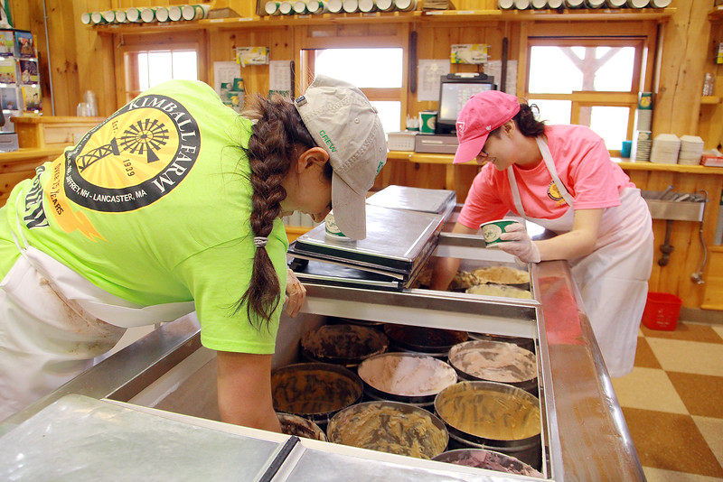 Noelle Viner, in green, and her sister Jackie Ledoux from Fitchburg scoop Ice-cream at Kimball Farm in Lancaster on Tuesday as the weather gets warmer. SENTINEL & ENTERPRISE/ JOHN LOVE