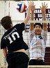 Bob Raines--Montgomery Media<br /> Tennent's Brendan Carter spikes the ball past Abington's Jay Yong Sung April 29, 2015.