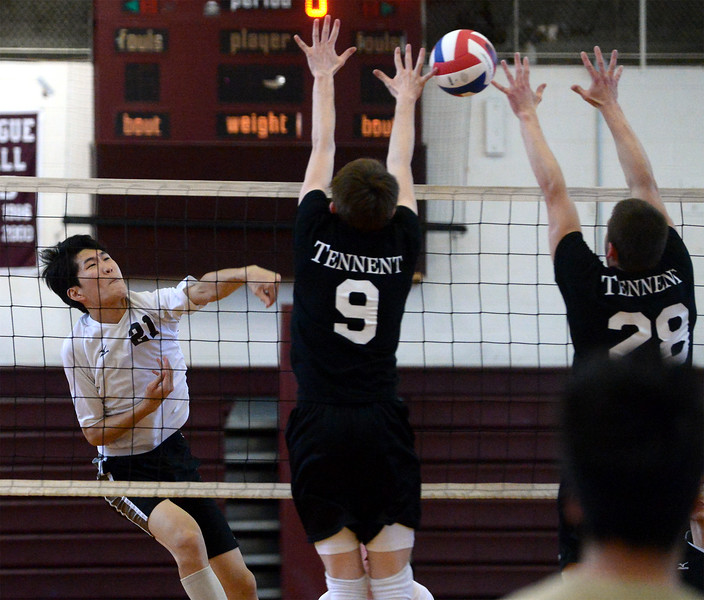 Bob Raines--Montgomery Media<br /> Abington's Jay Yong Sung spikes the ball past Tennent's Jay Milnazik and Tom Del Conte Wednesday, April 29, 2015.