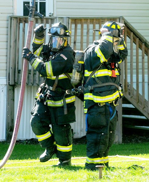 Jack Haley/Messenger Post Media<br /> Canandaigua firefighters prepare to enter a trailer which was filling up with smoke at 129 Saltonstall Street Monday afternoon. A second alarm was called bring crews from the VA, Crystal Beach and Farmington.