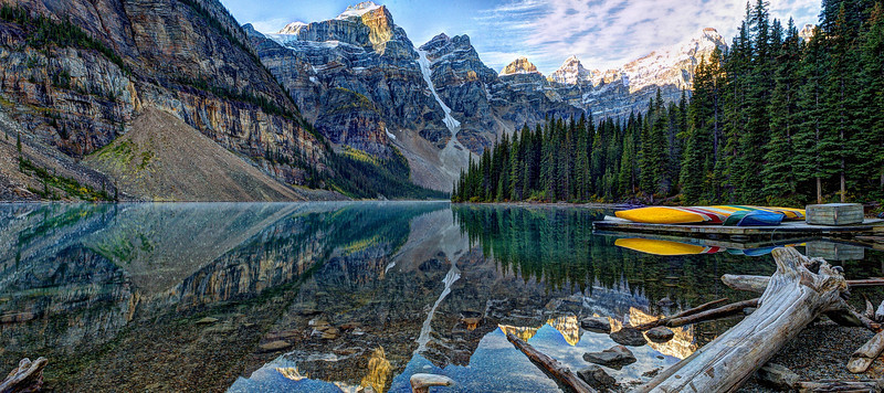 Canoes and reflections on Lake Moraine