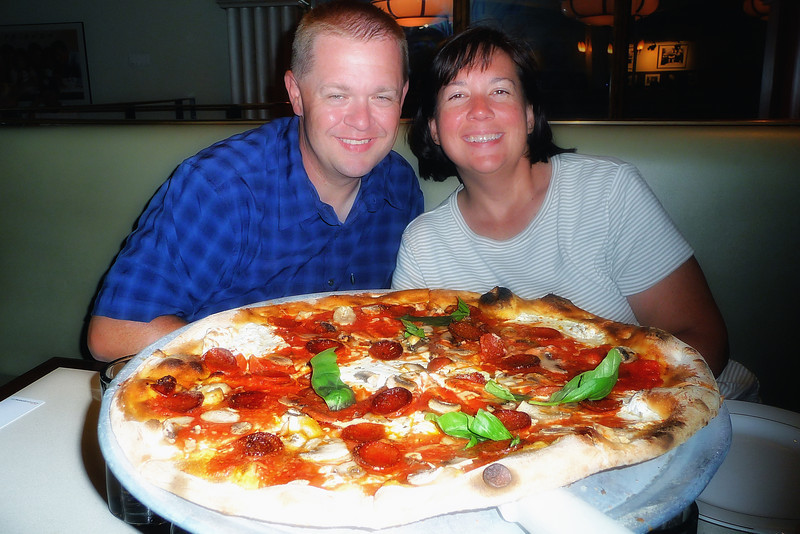 Rich and Michele, and a huge Angelo's pizza pie