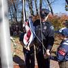 Scouts Mathew Terren and Ryan Davis with Lunenburg Patrol Officer Jon Broc raised the flag at the Veterans Memorial ceremony at Veterans Memorial Park in Lunenburg on Tuesday Morning. SENTINEL & ENTERPRISE / KYLE DAUDELIN