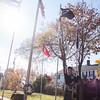 Former Lunenburg High principal Bob Gillis played God Bless America at Tuesday mornings Veterans Memorial in Lunenburg. SENTINEL & ENTERPRISE / KYLE DAUDELIN