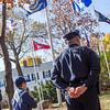 Scout Ryan Davis and Lunenburg Patrol Officer Jon Broc look on as Tom Alonzo of the Board of Selectmen gives the keynot speech at Tuesday's Veterans Memorial Ceremony. SENTINEL & ENTERPRISE / KYLE DAUDELIN