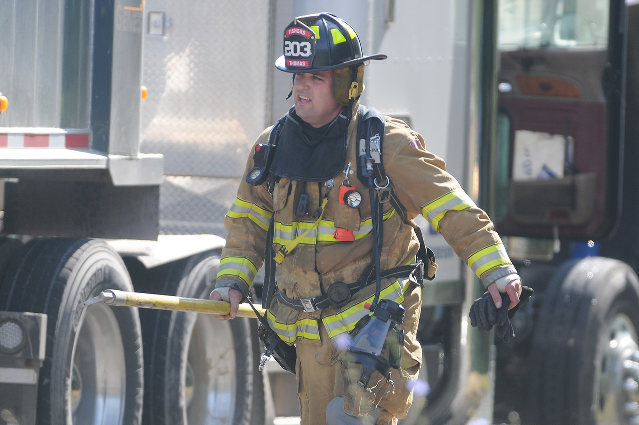 Jack Haley/Messenger Post Media<br /> Firefighters from Victor and Fishers responded to a tractor trailer on fire on County Road 41 just east of Route 444 late Wednesday morning.