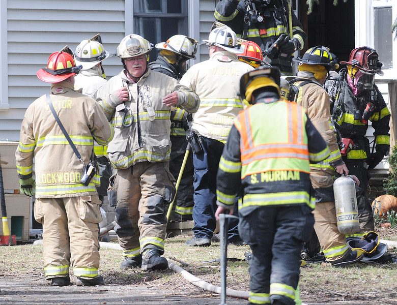 [Jack Haley/Messenger Post Media]<br /> Firefighters found a couple of dozen cats inside the house they were called to on Brace Road. A dog and a few cats were rescued from the structure.
