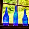 Three Blue Glass Bottles