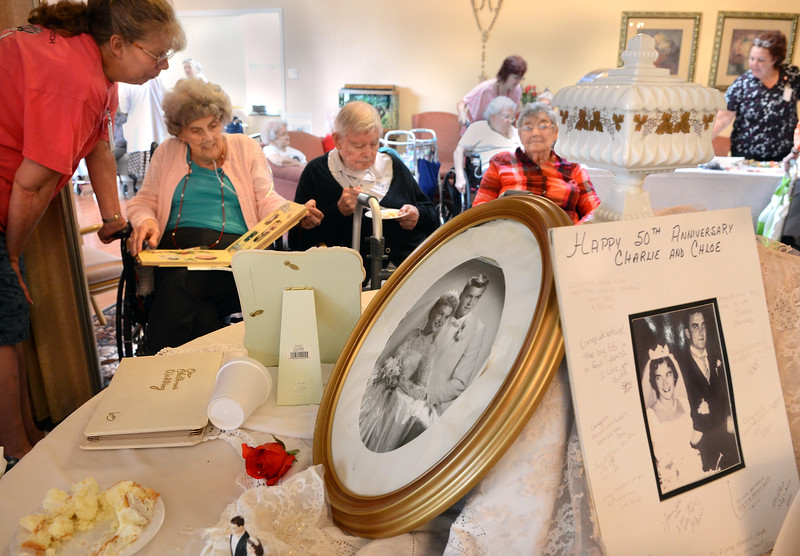A display of wedding photos ,gowns and memorabilla are seen of residents and staff of St Mary's Manor gathered during a show and display at the manor in Lansdale on Wednesday June 25,2014. Photo by Mark C Psoras/The Reporter