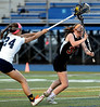 Bob Raines--Montgomery Media / <br /> Wissahickon's Carolyn Wilde tries to check Hatboro Horsham's Kaitlyn Wallace before she can shoot May 4, 2015.