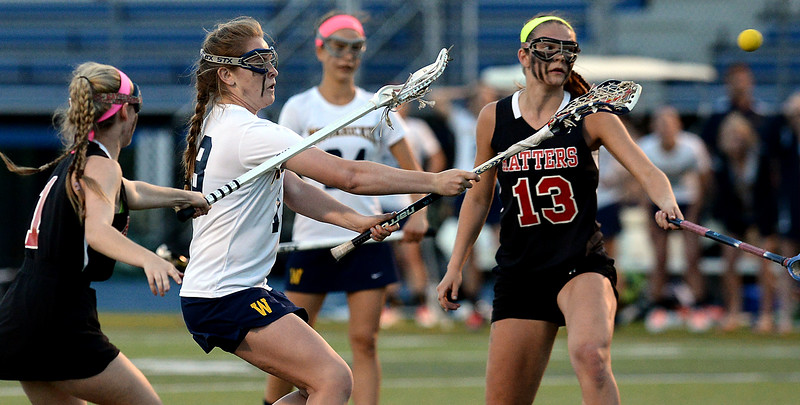 Bob Raines--Montgomery Media / <br /> Lauren Irvine fires a shoot on goal past Hatboro Horsham's Gwyn Acker, left, and Casey Swezey May 4, 2015.