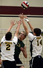 Bob Raines--Montgomery Media / Lansdale Catholic's Matt Plummer spikes the ball past Archbishop Wood's Ryan Harold and Brian Pietkarski during the PCL Volleyball Championship at Cairn University Friday, May 15, 2015.