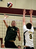 Bob Raines--Montgomery Media / Lansdale Catholic's Brendan Shovlin goes up to spike the ball past Archbishop Wood's John Waltrich Friday, May 15, 2015 during the PCL Volleyball Championship at Cairn University.