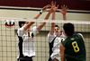 Bob Raines--Montgomery Media / Lansdale Catholic's John Van spikes the ball past Archbishop Wood's Ryan Harold and Brian Pietkarski  Friday, May 15, 2015 during the PCL Volleyball Championship at Cairn University.