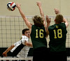 Bob Raines--Montgomery Media / Archbishop Wood 's Robert Russell spikes the ball past Lansdale Catholic's Matt Plummer and Brendan Shovlin during the PCL Volleyball Championship at Cairn University Friday, May 15, 2015.
