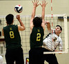 Bob Raines--Montgomery Media / Archbishop Wood's Ryan Harold spikes the ball past Lansdale Catholic's John Van and Jack Bagnell Friday, May 15, 2015 during the PCL Volleyball Championship at Cairn University.