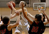 Bob Raines--Montgomery Media<br /> Archbishop Wood's Kate Connolly takes a shot over Archbishop Ryan's Shayla Rodriguez and Ashley Smink Thursday, Feb 19, 2015 at Philadelphia University.