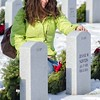 Joanne Dawson of Leominster pauses at the gravesite of her father Clinton Norton during the Wreaths Across America Ceremony at the Massachusetts Veteran's Memorial Cemetery in Winchendon SENTINEL&ENTERPRISE/ Jim Marabello